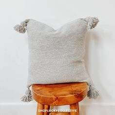 Handwoven Moroccan cotton pillow with pom pom detailing. Color is a gray. Cotton Pillow, Boho Decor, Vintage Rugs, Brown Leather, Hand Weaving, Textiles, Throw Pillows, Grey, Handmade