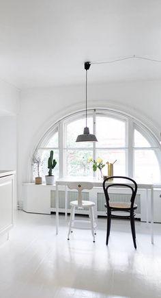 Home With A Round Kitchen Window Via