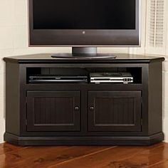Corner TV cabinet. I prefer the cherry stain but would really love to see this in navy (I'm obsessed now!). $500.