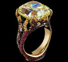Jewellery Theatre.Elements high jewellery Ring 18K Yellow Gold 1 fancy yellow cushion diamond 16,86-16,89 ct 10 diamonds 0,07-0,11 ct 66 yellow sapphires 0,13-0,16 ct 315 rubies 1,14-1,18 ct example 16,89 ct FIY/IF