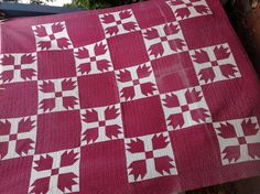 Old quilt bears paw pattern . I love the patina of this quilt .  Wonderful hand quilting