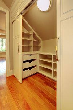 Attic Bedroom Closet Design - very cool. All but one of our closets are walk-in's that have the slanted roofline. This is a smart way to make every bit of space count