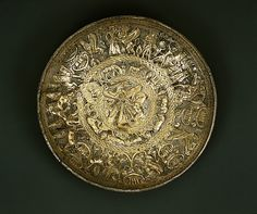 ilver-gilt bowl  Period: Archaic Date: ca. 725–675 B.C. Culture: Cypriot Medium: Gilt silver Dimensions: H. 1 1/4 in. (3.1 cm) diameter 6 5/8 in. (16.8 cm) Classification: Gold and Silver Credit Line: The Cesnola Collection, Purchased by subscription, 1874–76 Accession Number: 74.51.4554