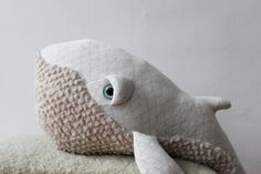 The small Albino Humpback Whale, made and designed for all ages! Made in France from Cotton Jacquard (top) and Acrylic faux fur (bottom). Stuffed with polyester fiber. With plastic safety eyes. Perfect companion for your little boy or the missing link in the kingdom of your little princess... or just to keep your couch warm! This creature was created to be a new member of the family ...  Measures: Length from nose to fin --> 62 cm (24 inches) Body Diameter (Widest part) --> 58 cm (23…
