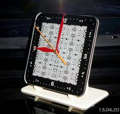 Desk clock made of 5 mm thick, black Lacobel glass.  Size 15 cm by 15 cm.