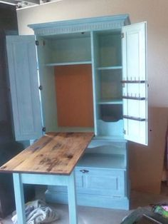 Repurposed armoire/ sewing cabinet. Fold table top & legs into cabinet. Use as woodwork station?
