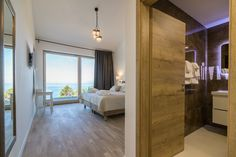 Natural wooden floor gives feeling of home. Sea view from king bed, large space of room and bathroom. Villa, Large Bathrooms, King Beds, Wooden Flooring, Luxury, Bedrooms, Instagram, Sea, Furniture