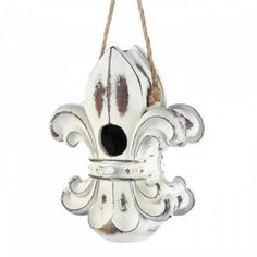 Fleur De Lis BirdhouseHere's a stylish European-styled home for the birds! This unique birdhouse looks like a regal fleur-de-lis ornament with a weathered white finish and a linen rope for hanging. Item weight: dimensions: W x .