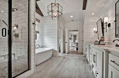 Welcoming craftsman style home with farmhouse touches in Arkansas - - This beautiful craftsman style home was designed by Celtic Custom Homes, located along Clear Creek in Fayetteville, Arkansas. Shiplap Bathroom Wall, Bathroom Interior, Wood Tile Bathroom Floor, Shiplap Ceiling, Bathroom Niche, Washroom, Bathroom Fixtures, Bad Inspiration, Bathroom Inspiration