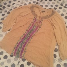 A bohemian style blouse A tan flowy blouse with a beautiful pink navy and green print in the center of the shirt with 3/4 lengths sleeves. Worn only once (only to try it on) 64 sixty five Tops Blouses