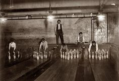 We've improved things a bit since then. Bowling started out just as this picture shows, with human pin setters. They did not have any electronic pinsetters or anything like that, they had actual humans set up the pins, clear the lanes after a throw, and return the bowling ball to the bowler. This picture motivates me to keep bowling and remember that I have it easy compared to my ancestors. Also this picture shows purpose and to help me achieve mastery and more knowledge of bowling.