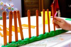 play dough and craft stick number line; mix up the sticks and have child put them in order, stuck into the play dough
