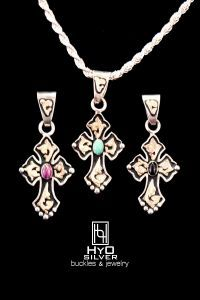 Cross Pendant Style RRP002-  Sterling silver medium cross with 10k and 14k gold overlay scroll work throughout the design.  A small gemstone is featured in the center.  Black antique background provides contrast to the bright silver and gold precious metals.  Black Onyx, Purple Turquoise, and Blue Turquoise options are available. www.hyosilver.com