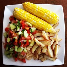 High carb dinner! Rice topped with fresh cucumber tomato and cilantro salad, side of roasted no oil potatoes, and corn on the cob! Easy, cheap, and healthy!