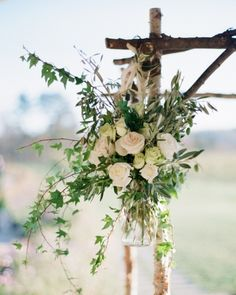 This simple chuppah was erected using river birch accented with jars of roses and various foliage