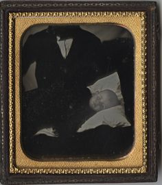 """I call this daguerreotype """"A Father's Heartbreak"""" and it is indeed a post mortem. The figure of a man standing over the baby lying on a pillow seems so poignant to me, as if he could not bear to let the little one go."""
