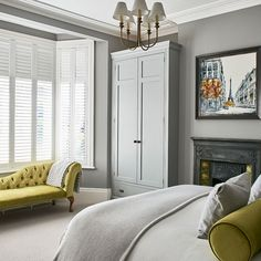 Grey bedroom with lime-green accessories