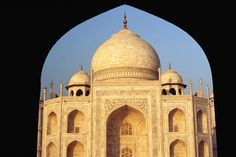 India. The Taj Mahal framed by an arch of the building built to provide symmetry with the mosque in the Taj Mahal grounds