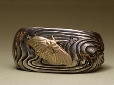 "Bracelet | Jim Kelso. ""Moth"". Sterling silver and 18k gold."