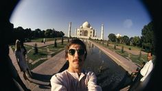 The Beatles' George Harrison taking a selfie in front of the Taj Mahal, 1966 Martin Scorsese, Ringo Starr, Paul Mccartney, John Lennon, Taj Mahal, Woodstock, Liverpool, Best Selfies, Celebrity Selfies