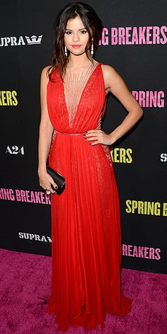 Selena Gomez in red Reem Acra gown with illusion panels at the Hollywood premiere of 'Spring Breakers'