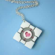 Laser cut acrylic Portal companion cube necklace.  --    I own this necklace and I love it!