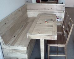 Kitchen Nook with flip-up bench lids for storage and dining-room table. Made for Andre and his family out of pallet wood and up-cycled pine bed frames. $450.