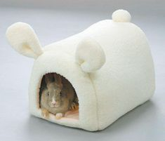 This rabbit house is ADORABLE, but my bunny would chew it to pieces.