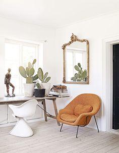 design Marie O. Nylander | photo sara svenningrud - colours - gold gilt mirror, london tan chair, soft green, bleached wood, white