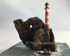 A personal favourite from my Etsy shop https://www.etsy.com/uk/listing/459123554/spyhole-rock-lighthouse