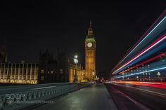 Light Trails to Parliament Night photography. Long exposure of a London Bus towards Houses of Parliament and Big Ben