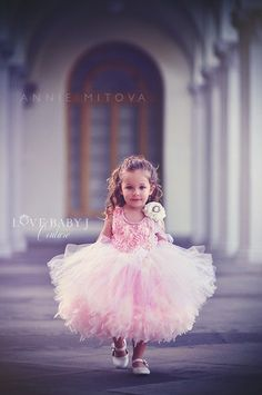 """Pretty Little Things""... A Couture Feather Tutu Flower Girl Dress ""Pretty Little Things"" is the perfect couture flower girl dress. The top of the bodice features a luxurious satin rosette material. T"