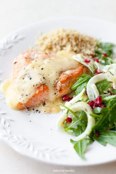 Salmon with lemon sauce with salad of fennel, arugula and pomegranate