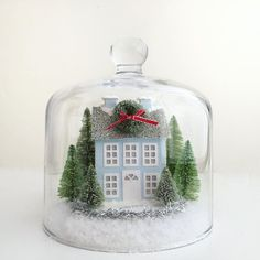 A quick holiday scene made with a candle cloche I found at Crate & Barrel...fits my Putz house ornaments perfectly! #etsyshop #putzhouse #diycrafts #glitterhouse #holidaycrafts #holidaydecorations #cloche #papercraft #christmasdecor #makersgonnamake #crafty #abmholidayspirit #crateandbarrel #creativelifehappylife