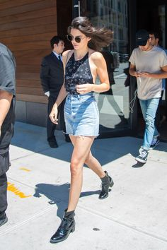 Kendall Jenner wearing a star tank-top, a denim mini skirt and Louis Vuitton boots while out in NYC.