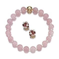 A ROSE QUARTZ AND CULTURED PEARL NECKLACE AND A PAIR OF GEM-SET EAR CLIPS, SEAMAN SCHEPPS, The necklace of rose-quartz beads with cultured pearl spacers to a ball clasp, length approximately 300mm; accompanied by a pair of ear clips designed as a cluster of cultured pearls and mixed-cut rose quartz and tourmaline highlighted by brilliant-cut diamonds, maker's marks for Seaman Schepps. Estimate   6,188 - 10,313USD  LOT SOLD. 7,735 USD