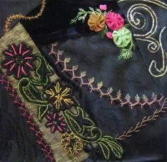This crazy-quilt block by Cathy K of Utah features colorful embroidery over black lace--dramatic!