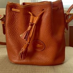 Dooney & Bourke Crossbody bag Dooney & Bourke authentic brown leather Crossbody bag. This bag is in great condition and fits a lot for a crossbody bag. Dooney & Bourke Bags Crossbody Bags