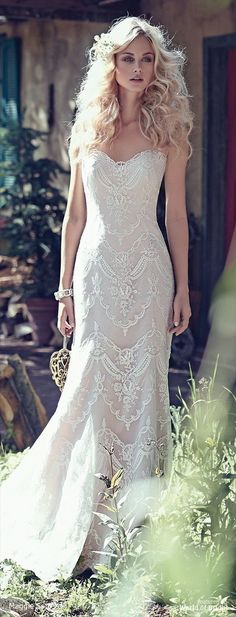 Elegant lace appliqués drift atop tulle to create this breathtaking bohemian sheath wedding dress, with a timeless, romantic sweetheart neckline. Finished with covered buttons over zipper and inner corset closure.