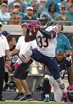 ac0d572de Chicago Bears cornerback Charles Tillman (33) intercepts a Jacksonville  Jaguars pass before running it