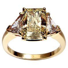 CARTIER Canary Diamond Ring   From a unique collection of vintage engagement rings at http://www.1stdibs.com/jewelry/rings/engagement-rings/