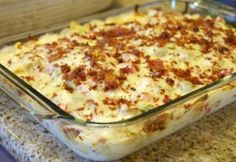 Chicken Bacon Ranch Casserole...1 lb. bacon, fried and crumbled, grease saved 2 lb. boneless, skinless chicken thighs 2 tablespoons of ranch seasoning 1 bell pepper, diced 2 clove garlic, minced 1 lb. bow tie pasta, 2 jars of Alfredo sauce 1/3 cup of evaporated milk or regular milk 3 roma tomatoes, diced  4 cups shredded Italian cheese blend