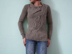 emmacr's wrapped.  love the way the cables travel across this sweater.