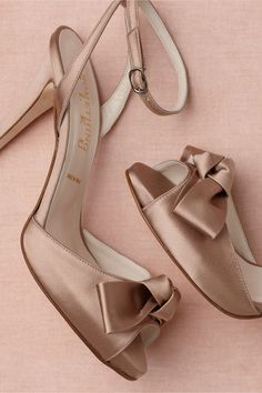 """Lambent Knot Heels  $310.00  Style: 25279043  Luminous bows sit prettily on a curving peep toe below a slender, coiled ankle strap. From Something Bleu. 4.5"""" satin-wrapped heel, covered 0.75"""" platform. Buckle closure. Satin upper; leather sole. Handmade in Italy."""