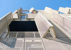 Perforated metal shutters, Cherokee Lofts by Pugh + Scarpa ARchitects Perforated Metal Panel, Metal Panels, Solar Panels, Building Skin, Building Facade, Facade Architecture, Contemporary Architecture, Metal Shutters, Metal Screen
