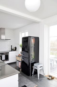 Kitchen love. Subway tile, stainless steel countertops, vintage refrigerator @Salt Studio NYC