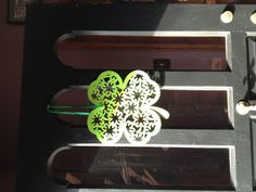 Found this at Michael's as a placemat so I simply cut a slit and added ribbon and hung it on the door for St. Patrick's Day. Very cheap and inexpensive.
