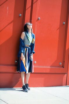 Irene Kim at New York Fashion Week Melt Sleepwear Robe + Low Classic Skirt + Nike Sneakers + Vintage Hollywood & Frica Bracelets