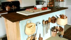 Sure, it's great for extra prep space, but your island can do so much more. Turn a basic kitchen island into storage central with these creative (and easy!) DIY add-ons.