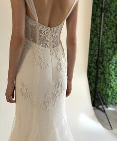 65d3b5d86b1 Ivory lace fit to flare bridal gown with cascading matte sequin floral  embroidery